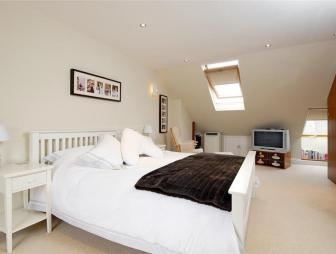 photo of beige white velux bedroom loft conversion with skylights carpet