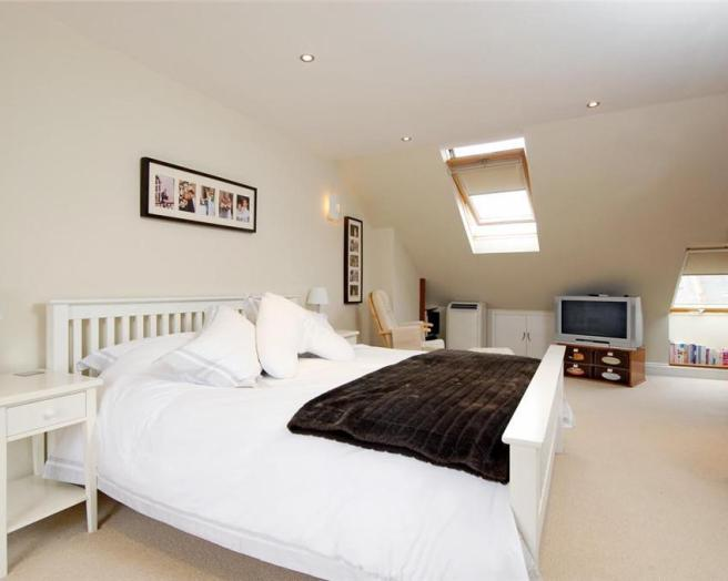 photo of beige white velux bedroom loft conversion with carpet