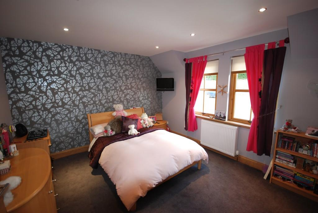 photo of brown pink bedroom with feature wall wallpaper