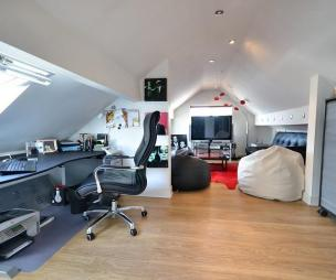 photo of beige white bedroom home office loft conversion office study with gabled ceiling soft furnishings and bean bag computer desk furniture power chair