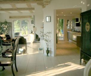 photo of airy bright open plan beige cream green olive kitchen living room