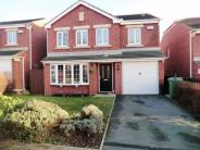 Detached property in Castle Lodge Way...