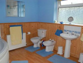 photo of blue orange white bathroom ensuite ensuite bathroom