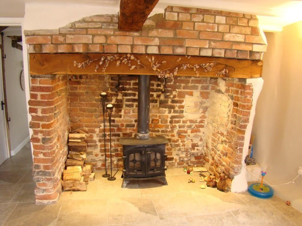 photo of beige orange with fireplace inglenook fireplace