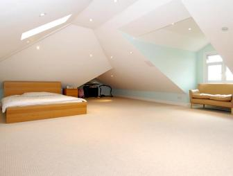 photo of beige white bedroom living room loft lounge with carpet and furniture sofa