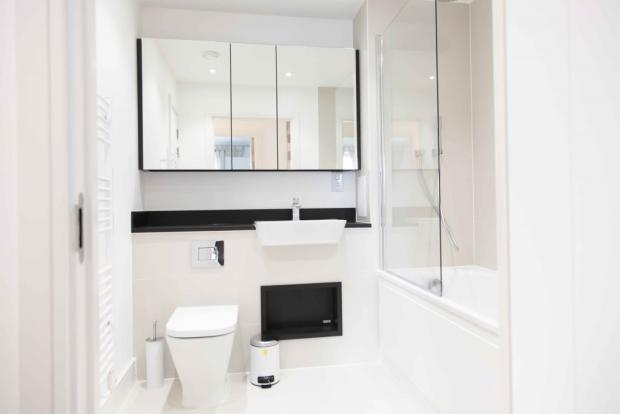 Three Piece White Tilled Bathroom