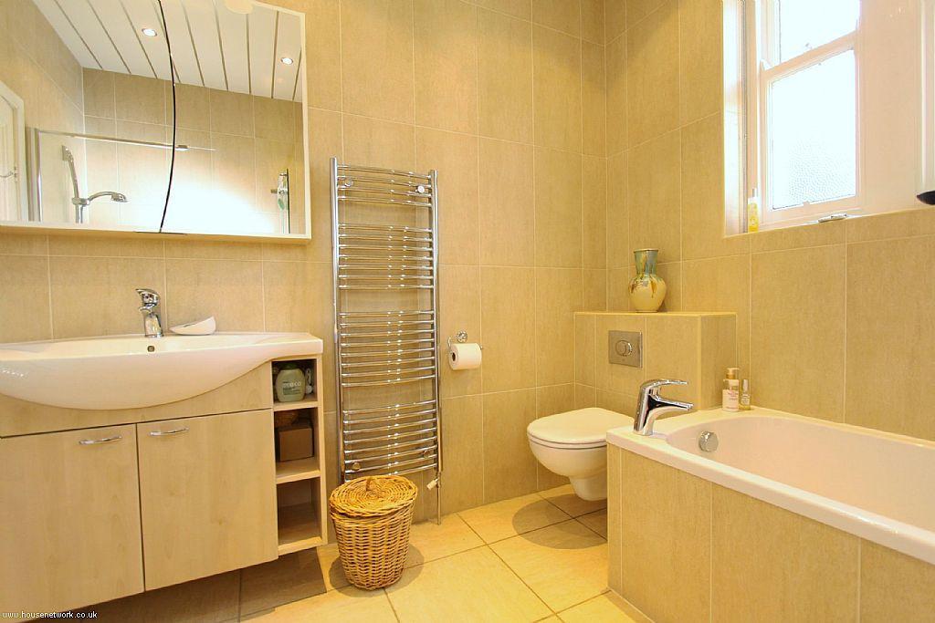 Beige orange family bathroom design ideas photos for Bathroom ideas rightmove