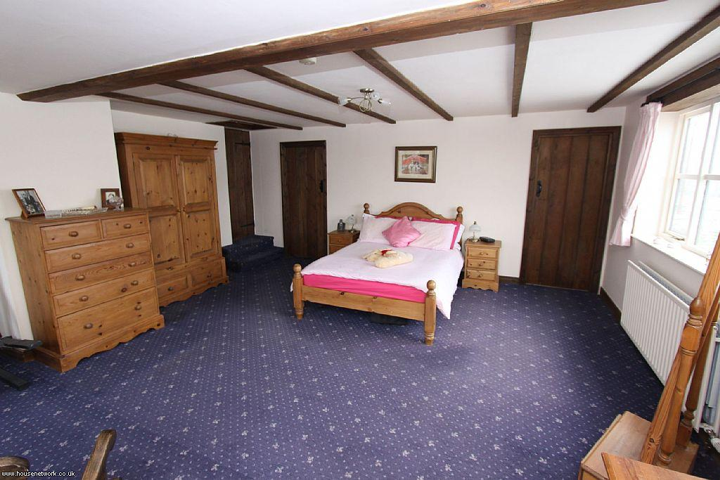 photo of tudor blue white wood bedroom with carpet