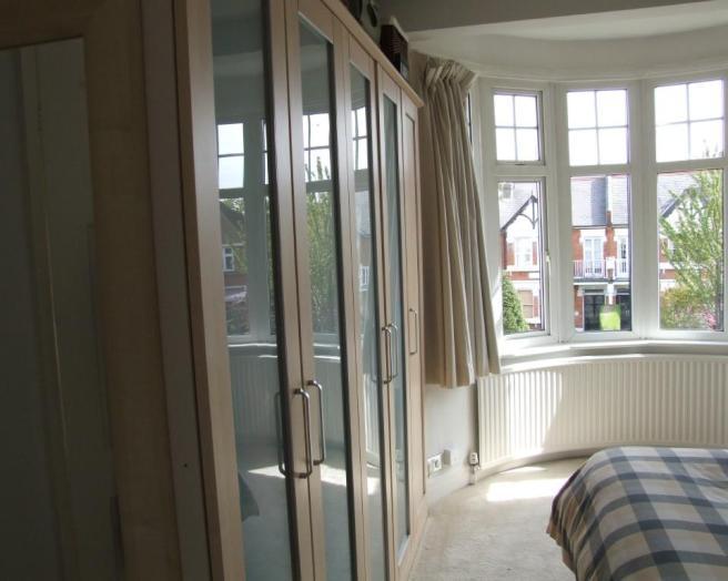 photo of bedroom with curved radiator radiators bay window
