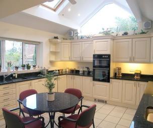 photo of beige white kitchen
