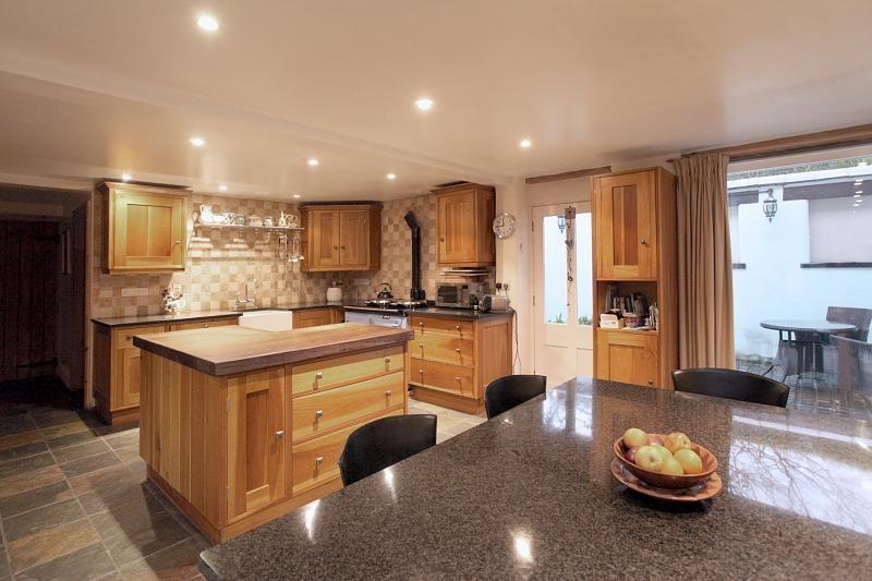 red beige brown pink lounge kitchen aga kitchen island wooden worktop