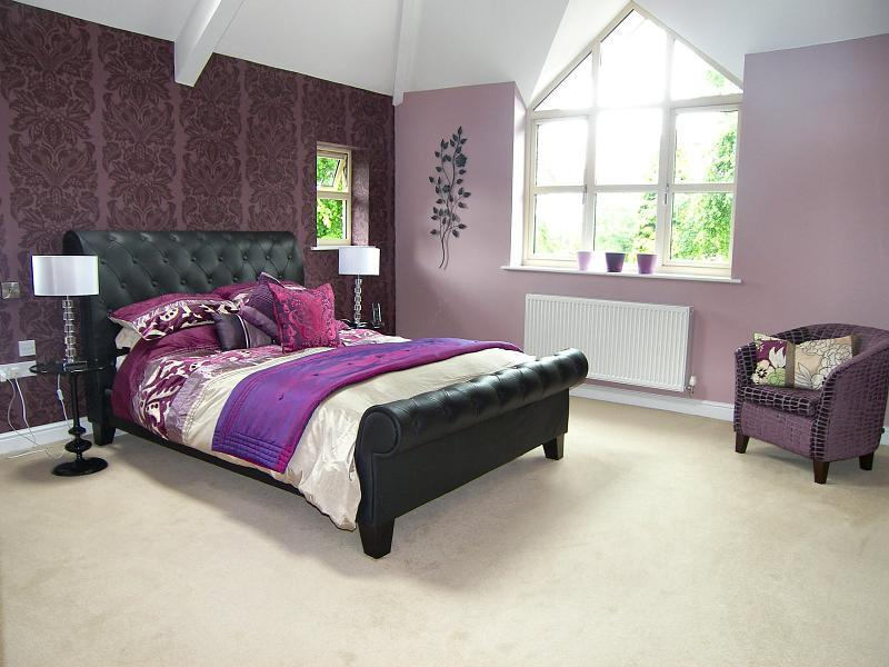 photo of beige pink purple white bedroom master bedroom with wall art