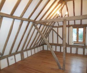 photo of period property beige brown white attic bedroom loft conversion with flooring oak beams wooden floor