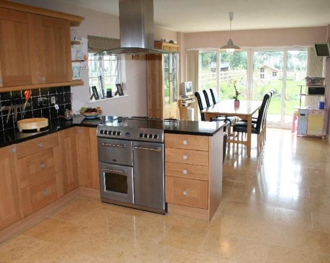 extension kitchen kitchen/diner with floor tiles flooring tiled floor
