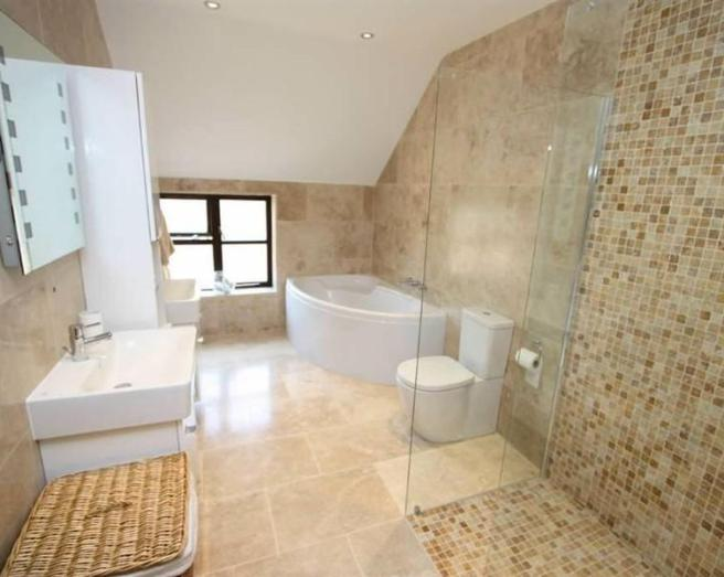 beige white ceramic floor tiles bathroom with bath corner bath shower