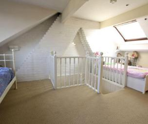 photo of beige white velux bedroom loft conversion with skylight