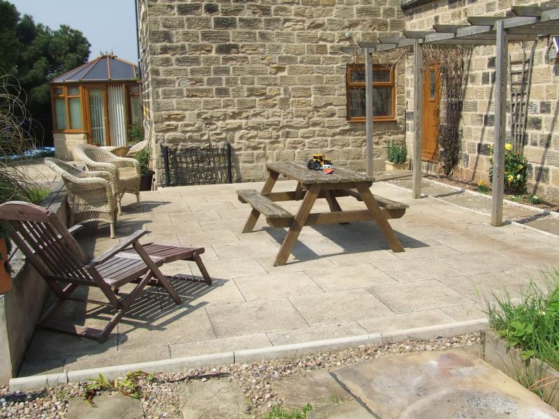 photo of garden and bench patio patio area