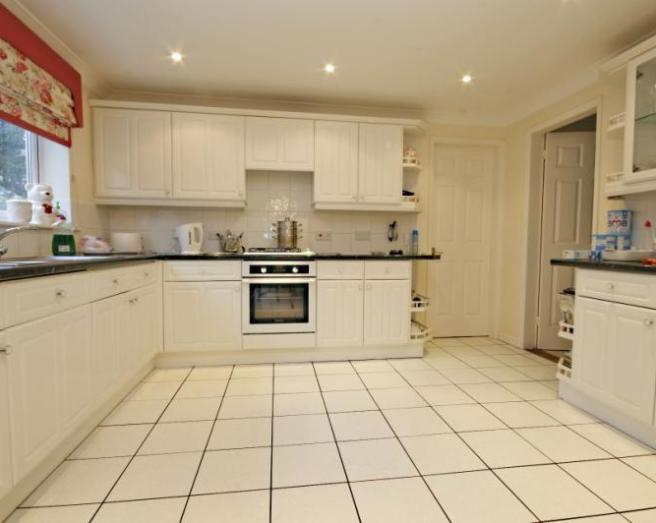 kitchen large kitchen with floor tiles flooring tiled floor blinds