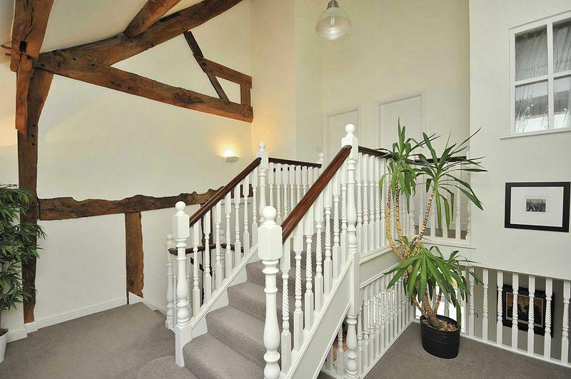 photo of beige cream white landing with balustrade