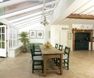 photo of contemporary cool farmhouse kitchen flooring/styles rustic traditional beige white conservatory kitchen kitchen extension with chandelier and aga