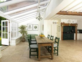 photo of contemporary cool country house kitchen farmhouse kitchen flooring/styles rustic traditional beige white conservatory kitchen kitchen extension with chandelier and aga country