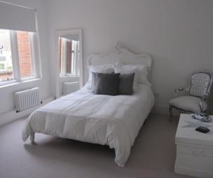 photo of white bedroom with carpet carpeted