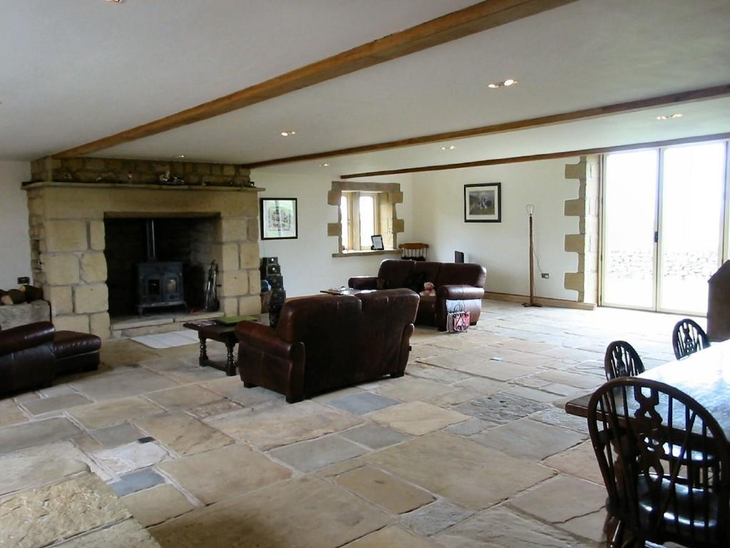 photo of white flagstones stone living room lounge with fireplace stone floor wood burner