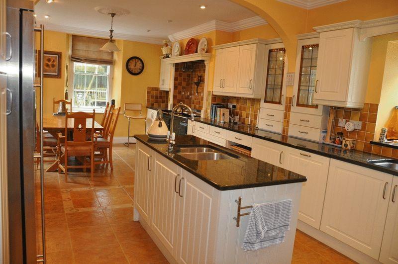 Beige brown kitchen island design ideas photos for Orange and brown kitchen decor