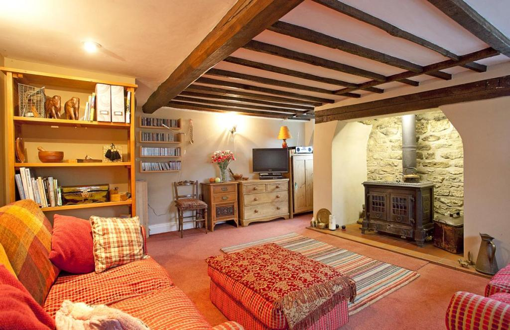 photo of cosy vibrant warm beige brown pink red lounge sitting room with fireplace inglenook fireplace wood burner