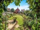 Rear garden and cott