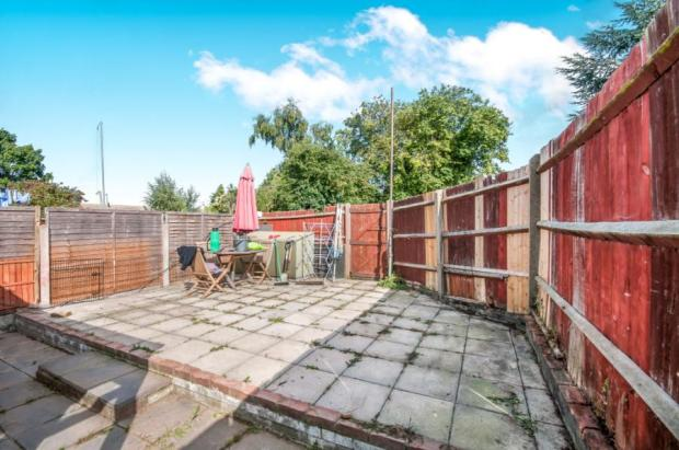 ... facing the rear and side overlooking the garden. Carpeted flooring and