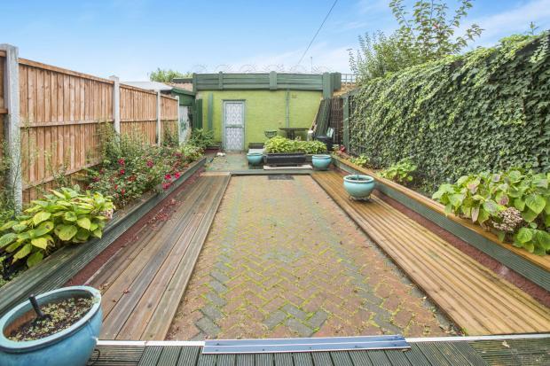 Rear garden with gar
