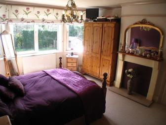 photo of black brown purple bedroom main bedroom with chandelier carpet roller blind