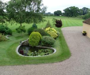photo of ornamental gravel garden and pond
