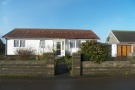 Detached Bungalow in Heol Llansaint...