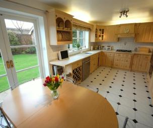 photo of beige brown white beech vinyl kitchen with lino and furniture wine rack