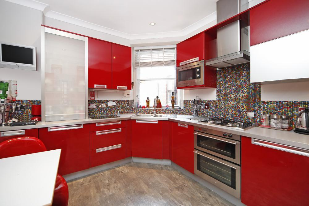 photo of red white kitchen with mosaic tiles tiles