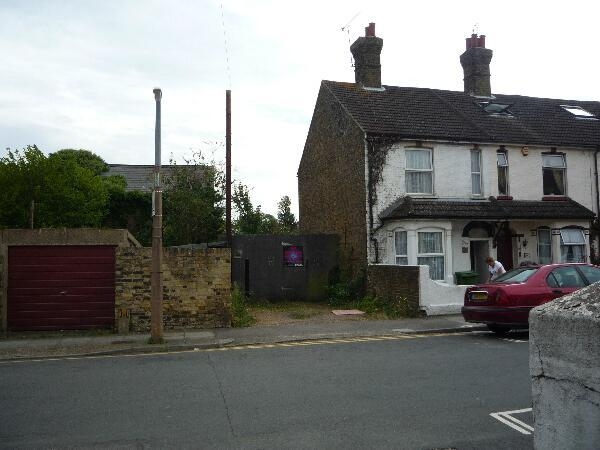 End of terraced house, garage, parking.