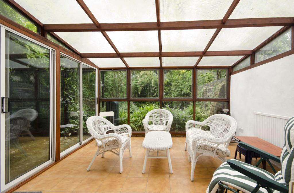 photo of beige green white conservatory
