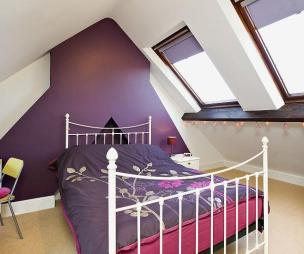 photo of beige purple white bedroom kids bedroom loft conversion with roof windows skylights