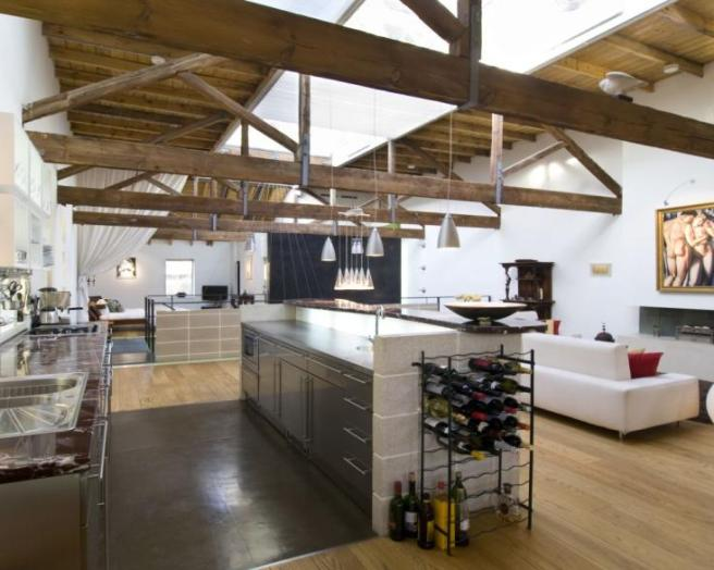 photo of industrial open plan brown white and furniture wine rack