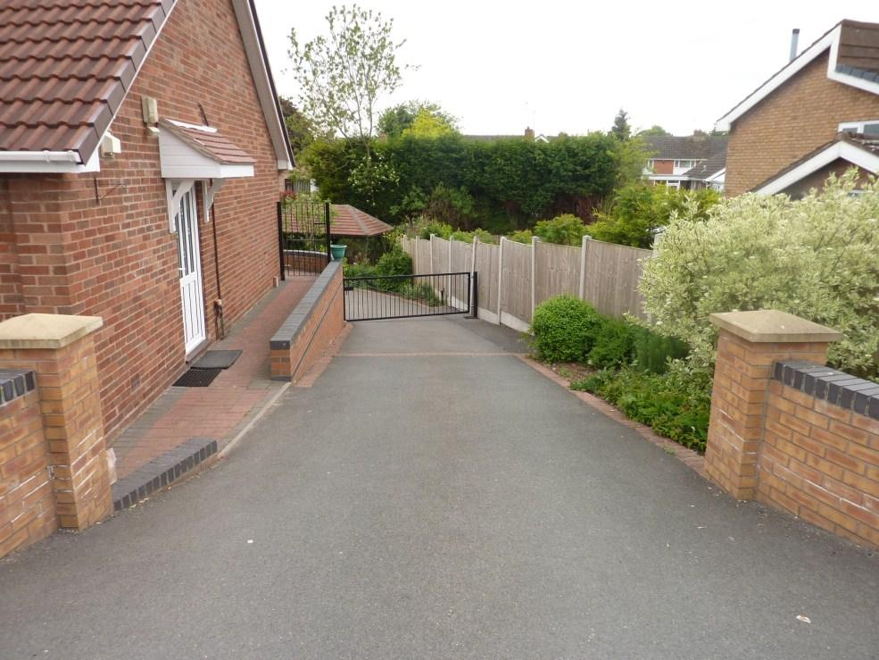 Side Driveway Leading to Rear Garden and Parking