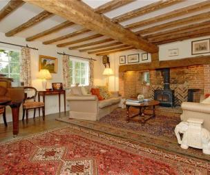 photo of fireplace with inglenook fireplace old beams wood burner rugs soft furnishings