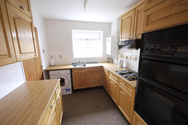 Tiled Kitchen:-