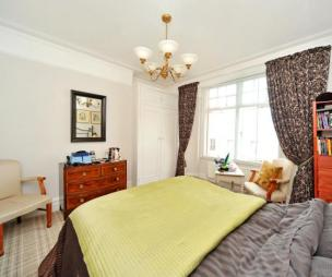 photo of white yellow metallic bedroom with carpet curtains soft furnishings tartan