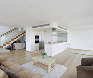 photo of calm contemporary minimalist modern natural open plan beige white living room with double oven stairporn stairs wooden floor rugs and air conditioning american fridge