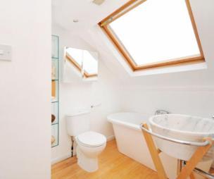 photo of beige orange white bathroom ensuite ensuite bathroom