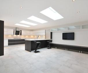 photo of contemporary luxury open plan black white kitchen with velux windows