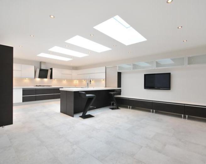 photo of contemporary luxury open plan black white kitchen with velux windows