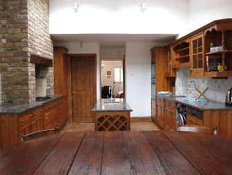 photo of country kitchen brown white kitchen with island kitchen brick fireplace fireplace